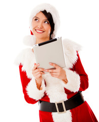 Thoughtful Mrs Claus with a tablet