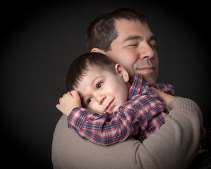 Father  hugging his beloved son .