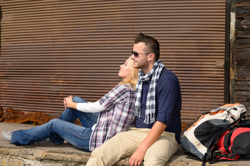 Couple resting backpack travel tired sitting trip