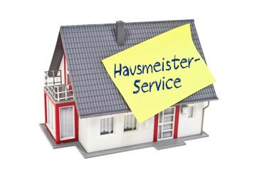 Haus mit Zettel und Hausmeisterservice