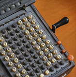 Italy, old calculator on a table