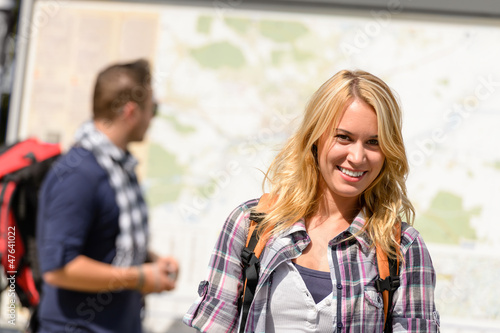 Couple backpack traveling on holiday smiling map