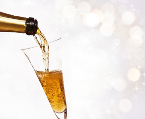 Christmas background with pouring champagne