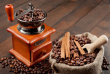 coffee grinder and sack with coffee beans