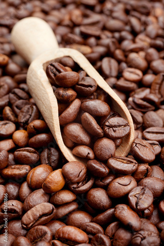 coffee beans and wooden scoop
