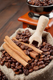 sack with coffee beans and coffee grinder