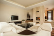 Travertine house: designer living room