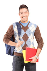 A handsome male student school bag holding books