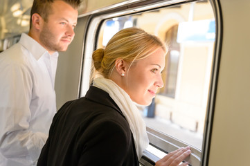 Man and woman looking out train window