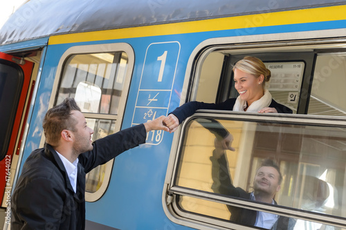 Woman leaving with train man holding hand