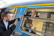 Man saying goodbye to woman on train