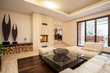 Travertine house: beige living room