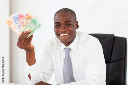african businessman with south african cash notes