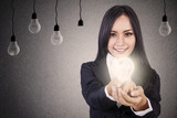 Businesswoman give bright idea