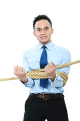 businessman tied with ropes