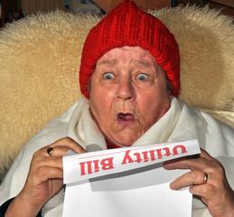 Elderly Woman Reading Utility Bill