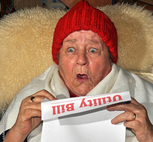 Elderly Woman Reading Utility Bill