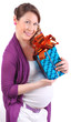 Pregnant woman with flower in hair hugs box with gift isolated