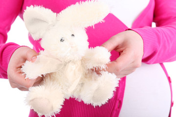 Pretty toy rabbit with unreal design and belly of pregnant woman
