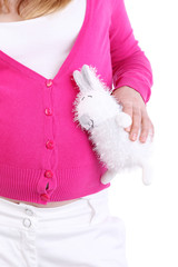 Pregnant woman holds white toy rabbit isolated on white