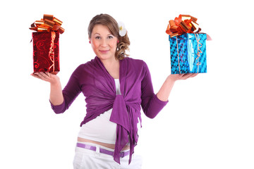 Smiling pregnant woman holds red and blue boxes with gift