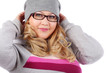Young beautiful woman in glasses and gray hat looks at camera