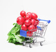 Bunch of fresh pink radish with leaves in shopping cart