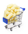 Tasty yellow sweet corn sticks in shopping cart isolated