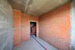Red brick walls in room of building under construction