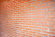 Close up of red brick walls in room of building
