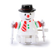 White plastic toy mechanical snowman on skis isolated on white