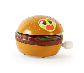 Plastic toy mechanical hamburger isolated on white background.