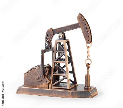 Metal mechanical miniature oil derrick isolated on white