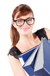Happy girl in big glasses holds three large blue folders