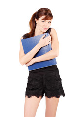 Girl in black holds large blue folder isolated on white