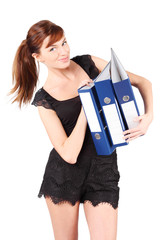 Smiling girl in black holds three large blue folders isolated