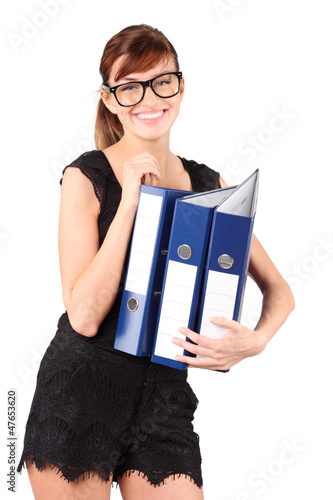 Smiling girl in big glasses holds three large blue folders