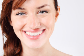 Close-up of beautiful smiling young and pretty caucasian woman.