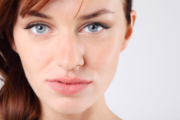 Close-up of beautiful melancholy pretty caucasian woman