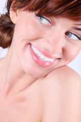 Close-up portrait of beautiful smiling young caucasian woman