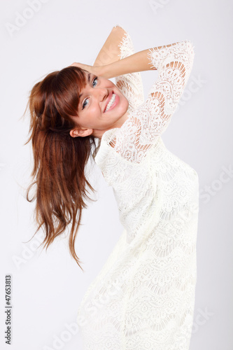 Portrait of beautiful young caucasian woman in white