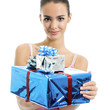 Young smiling woman with gifts, isolated