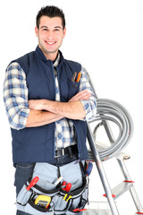 electrician with arms crossed