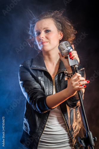 Beautiful young woman on the stage