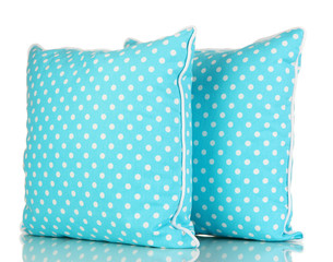 Blue bright pillows isolated on white