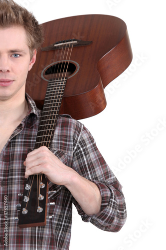 young man with an acoustic guitar
