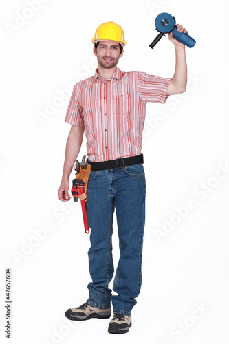 A handyman holding a grinding machine.