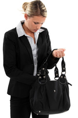 businesswoman searching through her bag