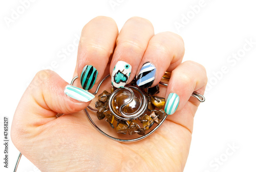 Female hands with luxory jevelery and blue modern manicure
