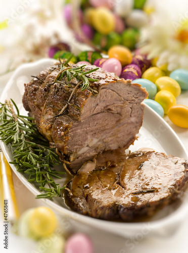 roasted meat over easter table, selective focus